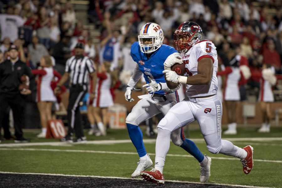 Western Kentucky University running back Marquez Trigg (5) runs in for a touchdown during he Hilltoppers' 50-3 win over Houston Baptist University on Saturday Oct. 1, 2016 at L.T. Smith Stadium.