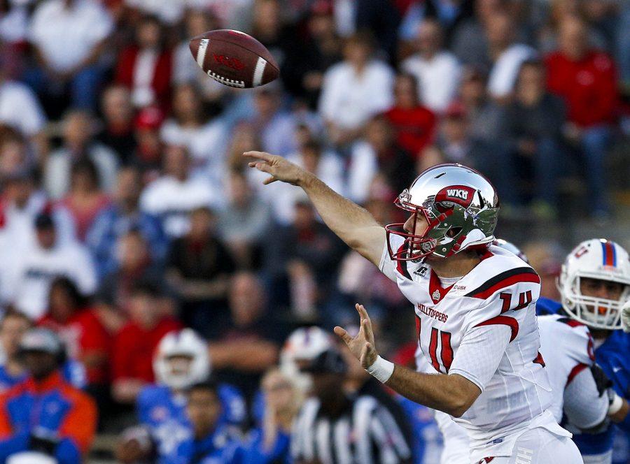 Redshirt junior quarterback Mike White (14) makes a pass during WKU's 50-3 win over Houston Baptist Saturday, Oct. 1 at Smith Stadium. Ebony Cox/HERALD