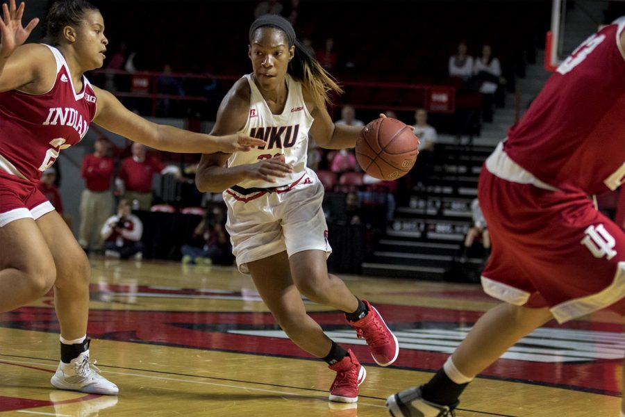 Sophomore+guard+Kayla+Smith+%2832%29+makes+a+break+for+the+basket+while+Indiana+Hoosiers+junior+forward+Amanda+Cahill+%2833%29+reaches+for+the+ball+during+the+Lady+Toppers+85-74+win+against+Indiana+University+Saturday+Nov.+19%2C+2016+at+E.A.+Diddle+Arena.