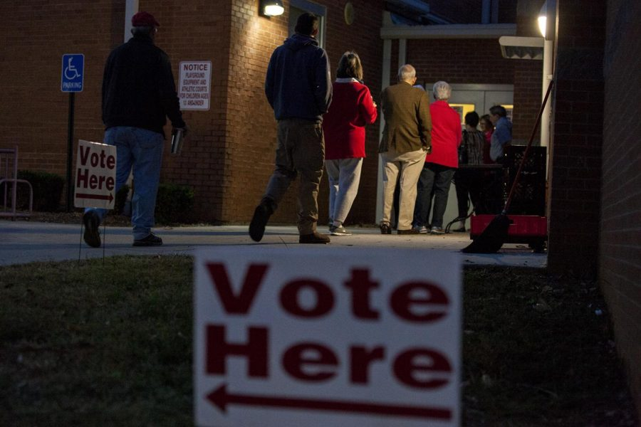 Voters+wait+in+line+to+cast+their+ballot+on+Tuesday+Nov.+8%2C+2016+at+McNeill+Elementary+School.
