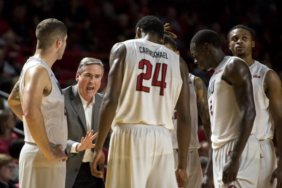 Head coach Rick Stansbury talks to the Hilltoppers during WKUs 103-97 double-overtime win against Kentucky Wesleyan on Saturday, Nov. 5, 2016, at Diddle Arena.