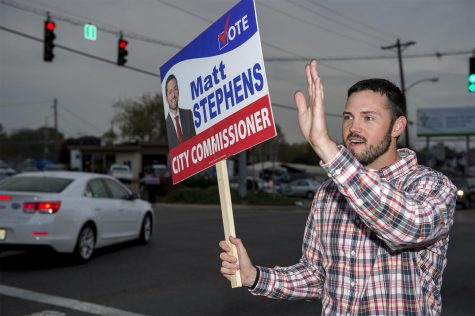 """Matt Stephens, of Bowling Green, wavies to supporters in hopes to get them to vote for him at the polls for City Commissioner during the Nov. 8, 2016 election in Bowling Green, Kentucky. """"It"""