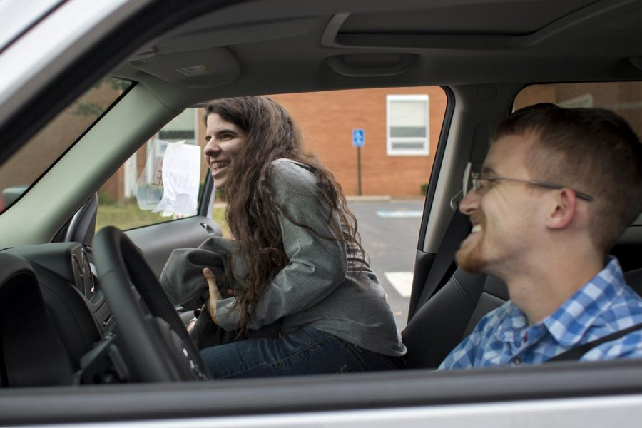 Elizabethtown junior Remington Grenier gets into Olive Hill junior Ty Knipp's car after voting on Tuesday, Nov. 8 at W.R. McNeill Elementary. Knipp volunteered to drive students for Ride To Vote, a free shuttle service for students to their polling place.