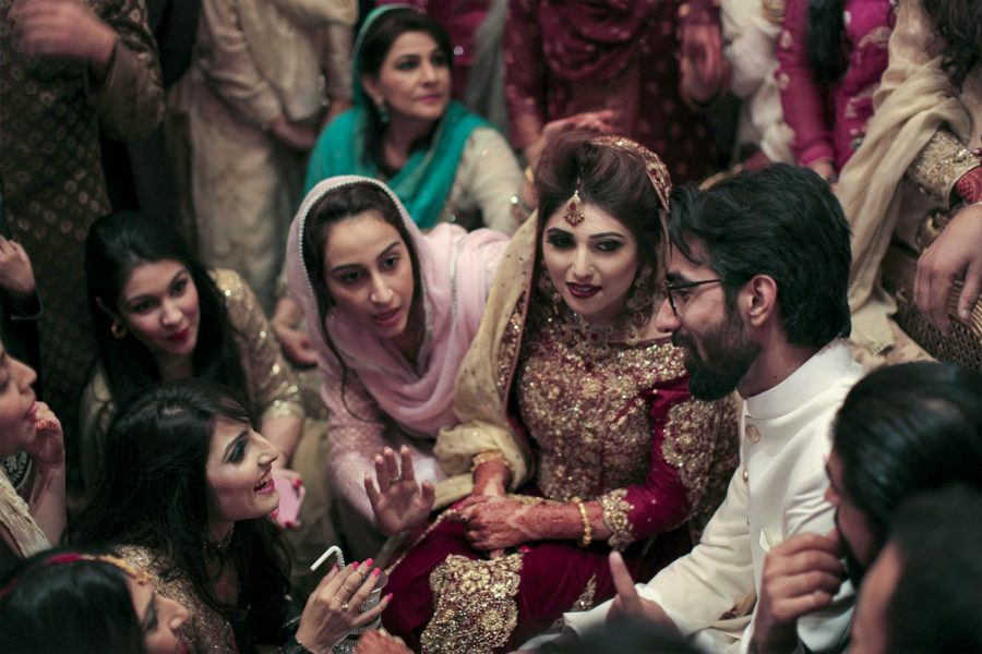 Newlyweds%2C+Ayaz+and+Ayesha+Sadal+%28center%29+are+harrased+for+money+by+their+friends+and+family+for+drinking+milk+from+a+silver+chalice+during+their+Baraat+ceremony+in+Lahore%2C+Pakistan.+Baraat+is+a+portion+of+the+wedding+event+where+the+groom+takes+his+bride+home+to+her+new+family.+In+Pakistani+tradition+the+bride+and+groom+are+pestered+by+their+friends+and+family+to+fork+over+money+in+exchange+for+acceptance+by+the+in-laws.+Alyse+Young%2FHERALD
