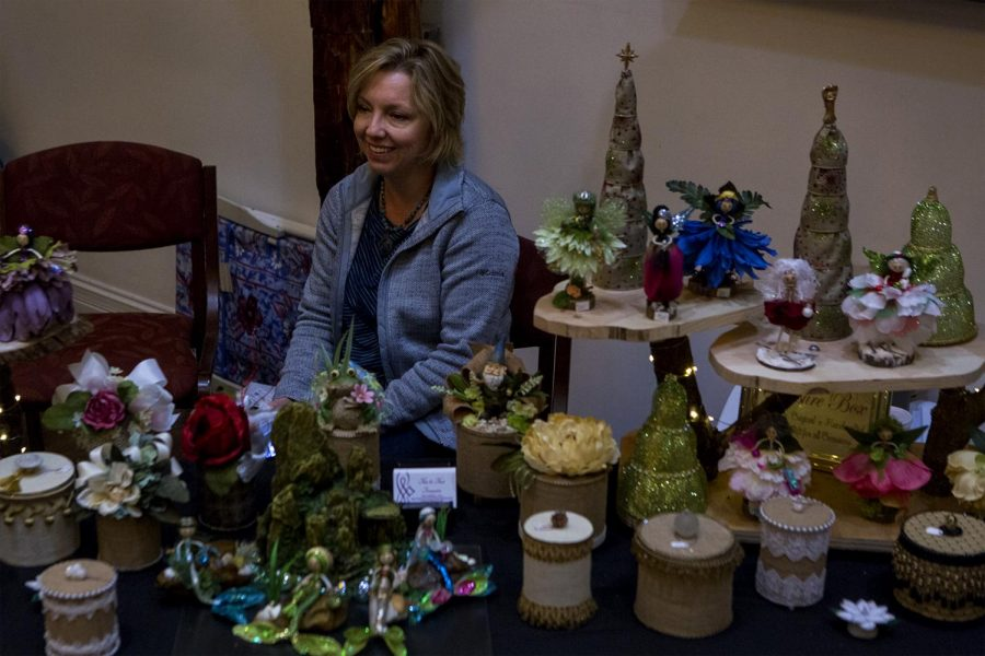 Jan Brockman of Bowling Green sits at her mother's craft table during the Political Science Annual Craft Show on Friday, Nov. 11. Brockman's mother makes handmade fairies and treasure boxes.