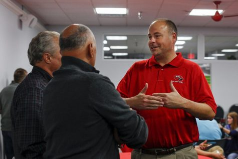 Political science professor Scott Lasley mingles with attendees during the republican viewing party on Tuesday Nov. 8, 2016 at the Republican Party of Warren County Headquarters. Lesley is the chair of the Republican Party of Warren County.