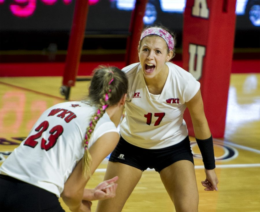 Freshman outside hitter Sophia Cerino (23) celebrates with senior defensive specialist Kaelin Grimes (17) after scoring a point against UAB Friday, Oct. 14, at Diddle Arena. Jeff Brown/HERALD