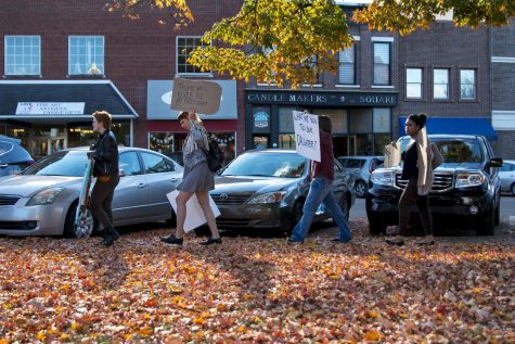 """A group of protestors walk through Fountain Square Park in downtown Bowling Green holding up anti-Trump signs to passing cars and people in the area on Wednesday Nov. 9, 2016. """"...I"""