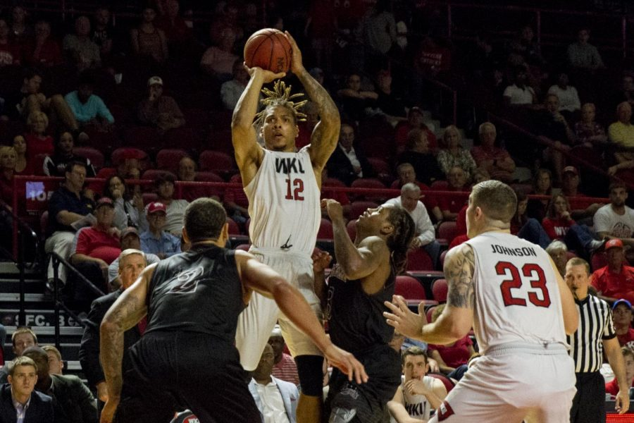 Redshirt+senior+guard+Pancake+Thomas+%2812%29+jumps+over+the+defense+to+make+a+shot+during+the+men%27s+basketball+87-79+victory+over+Campbellsville+University+at+Diddle+Arena+on+Tuesday+Nov.+1.+Thomas+scored+17+of+the+Topper%27s+87+points.+Kathryn+Ziesig%2FHERALD