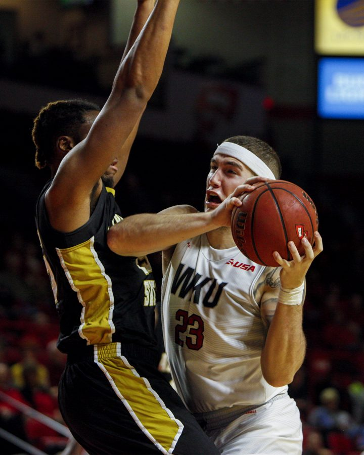 Junior forward Justin Johnson (23) drives to the basket during the Hilltoppers 79-66 win over Alabama State on Nov. 12, at Diddle Arena. Ebony Cox/HERALD