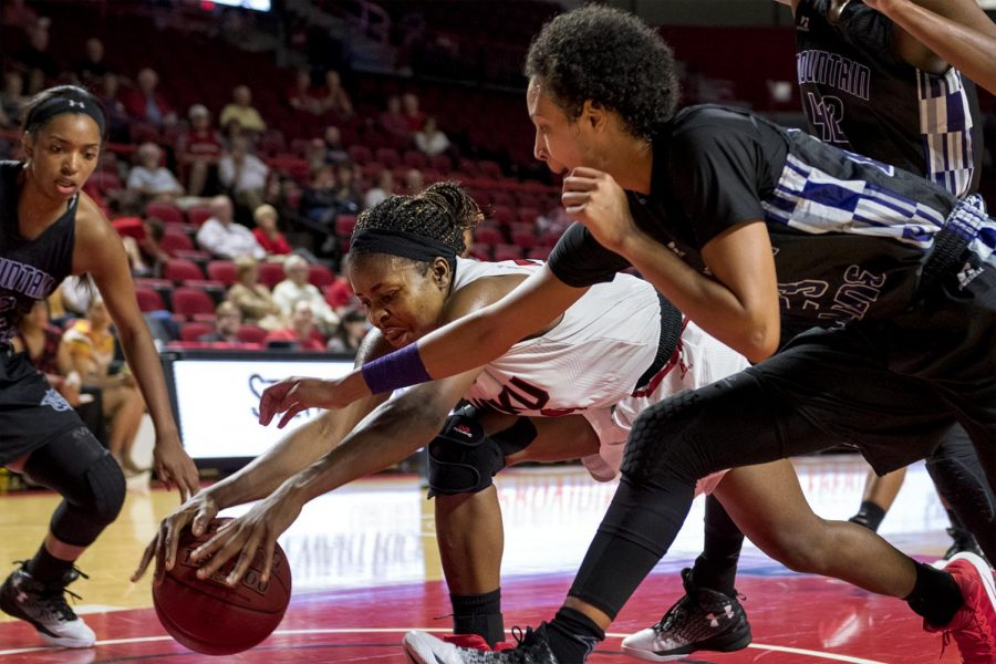 WKU%27s+senior+Ima+Akpan+%2820%29+dives+for+a+loose+ball+against+a+couple+of+Young+Harris+College+defenders+during+the+Lady+Topper%27s+98-51win+on+Thursday+Nov.+03%2C+2016+at+E.A.+Diddle+arena.