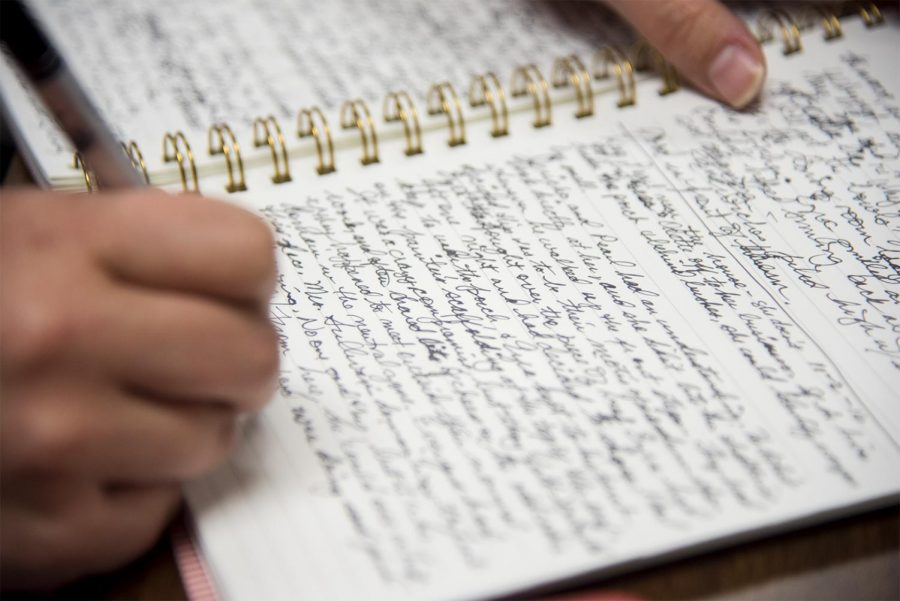 Esther French, 44, a creative writing major at WKU, writes during a