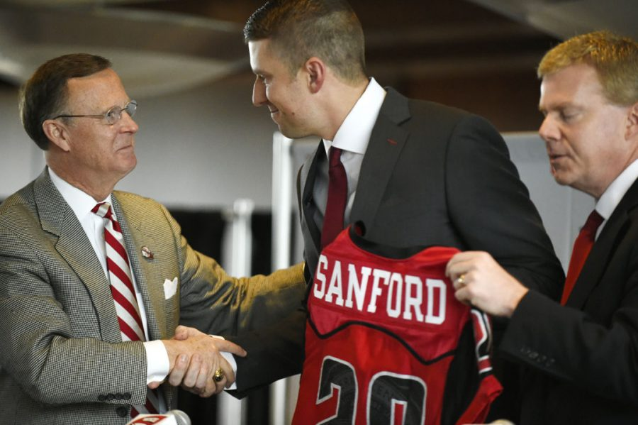Western Kentucky University President Gary Ransdell shakes the hand of Mike Sanford after announcing as the new head football coach for Western Kentucky University on Dec. 14, 2016 at L.T. Smith Stadium in Bowling Green, Ky.