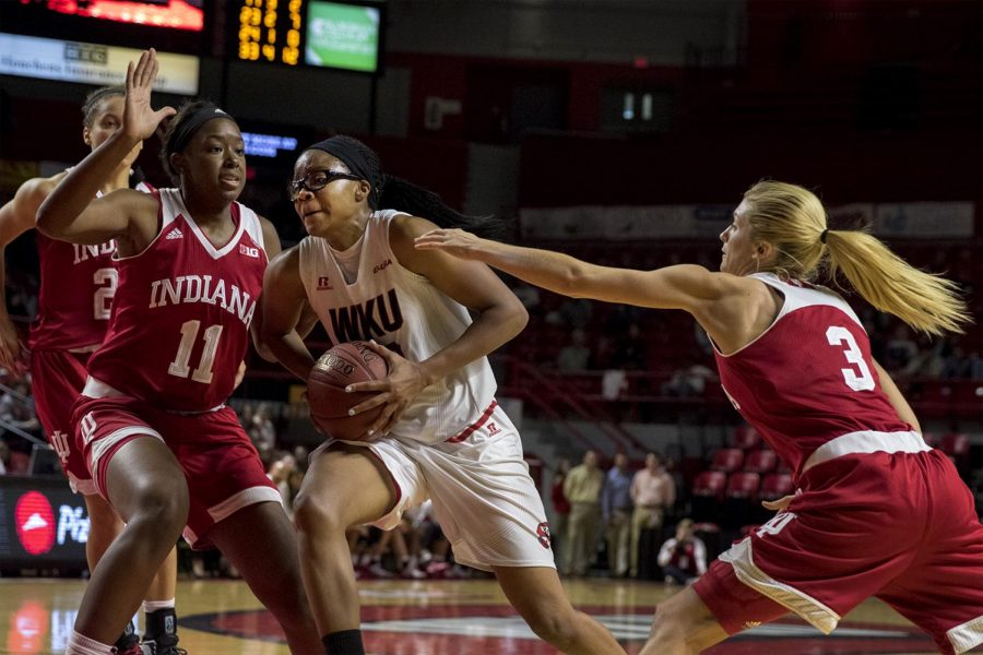 Junior+forward+Tashia+Brown+%2810%29+gets+ready+to+go+up+for+the+layup+while+Indiana+Hoosiers+Junior+guard+Tyra+Buss+%283%29+and+forward+Kym+Royster+%2811%29+defendduring+the+Lady+Toppers%27+85-74+win+against+Indiana+University+Saturday+Nov.+19%2C+2016+at+E.A.+Diddle+Arena.