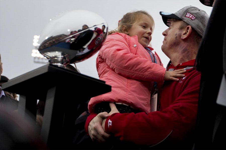 Head coach Jeff Brohm smiles at his daughter, Brooke, after WKUs 58-44 victory over Louisiana Tech at the Conference USA Championship on Dec. 3, 2016 at L.T. Smith Stadium. Kathryn Ziesig/HERALD
