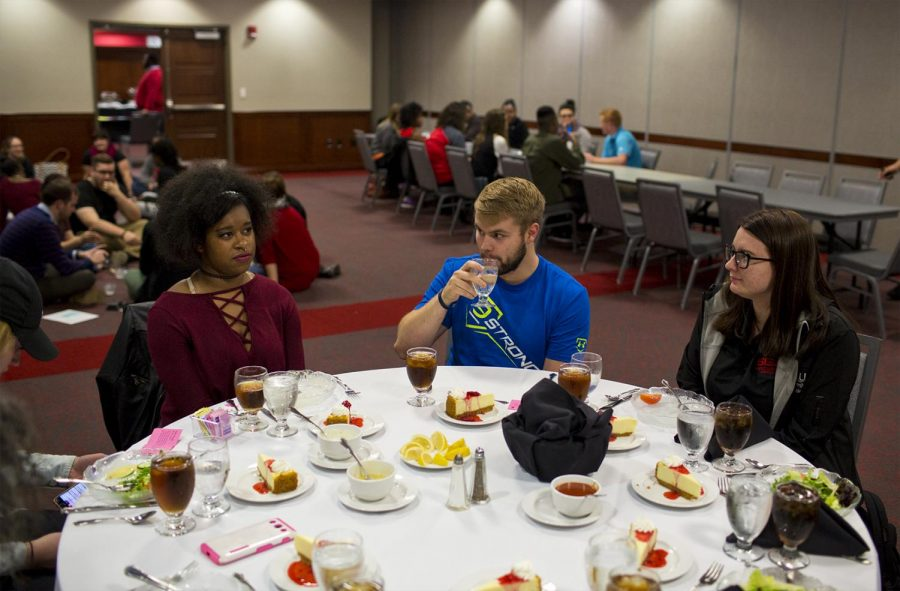Foot Hood, Texas freshman Thai Bryant (left), Louisville, Ky. junior Shelby Campbell (middle) and Winchester, Ky. sophomore Emily Houston (right) eat their meal during the Hunger Banquet hosted by Housing Residents Life on Tuesday, Nov. 29, 2016 in DSU. The students were divided into upper, middle and lower class and their meals were based on their class status. This interactive event helped students better visualize the reality of world hunger. Michelle Hanks/HERALD