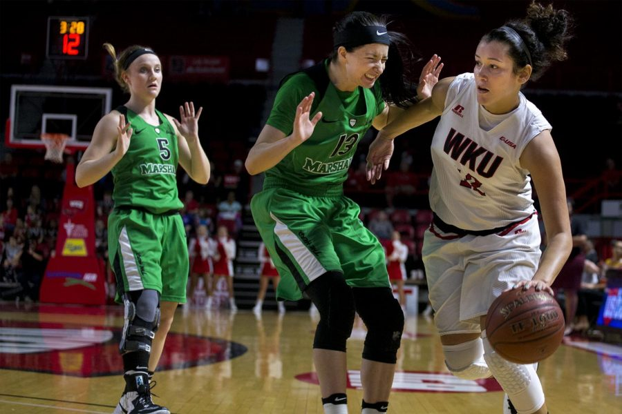 Senior+Guard+Kendall+Noble+%2812%29+drives+in+toward+the+basket+as+Marshall+University+junior+Guard+Taylor+Porter+%2813%29+defends+her+during+the+first+half+of+the+Lady+Toppers+73-57+win+over+Marshall+on+Saturday+Jan.+21%2C+2017+at+Diddle+Arena.