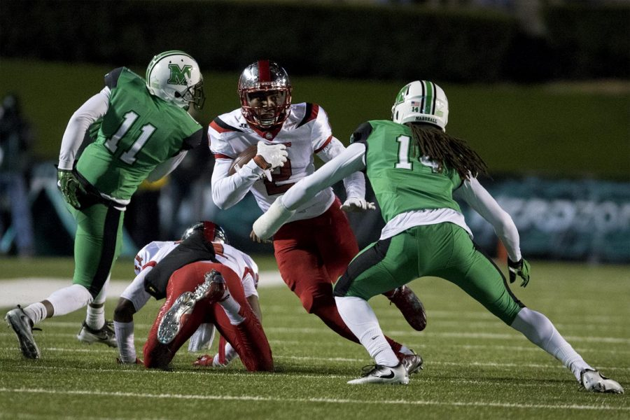 WKU+wide+receiver+Taywan+Taylor+%282%29+tries+escape+a+tackle+by+Marshall+University+safety+Kendall+Gant+%2814%29+during+the+Hilltoppers%27+60-6+win+over+Marshall+on+Saturday%2C+Nov.+26th%2C+2016+at+Joan+C.+Edwards+Stadium+in+Huntington%2C+WV.+Evan+Boggs+%2F+HERALD