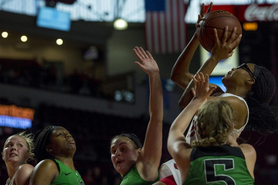 Lady+Toppers+forward+Tashia+Brown+%2810%29+shoot+the+ball+as+she+is+defended+by+Marshall+University+players+during+the+Lady+Toppers%27+73-57+win+over+Marshall+University+on+Saturday+Jan.+21%2C+2016+at+E.A.+Diddle+arena.