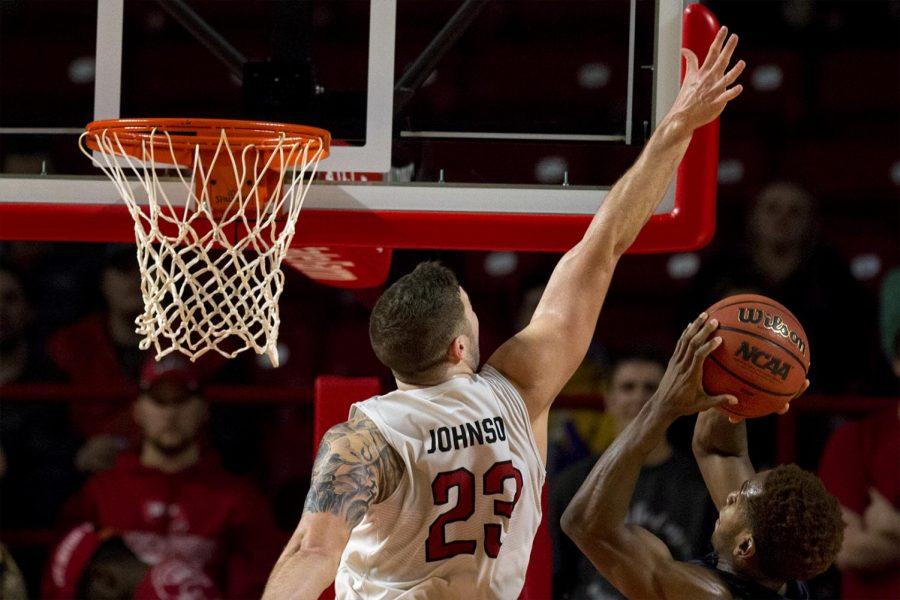 Junior+forward+Justin+Johnson+%2823%29+jumps+to+block+UTEP+guard+Dominic+Artis+%2815%29+during+WKU%27s+65-62+victory+over+UTEP+on+Thursday+Jan.+26%2C+2017+at+E.A.+Diddle+Arena.+Johnson+made+recovered+12+rebounds.