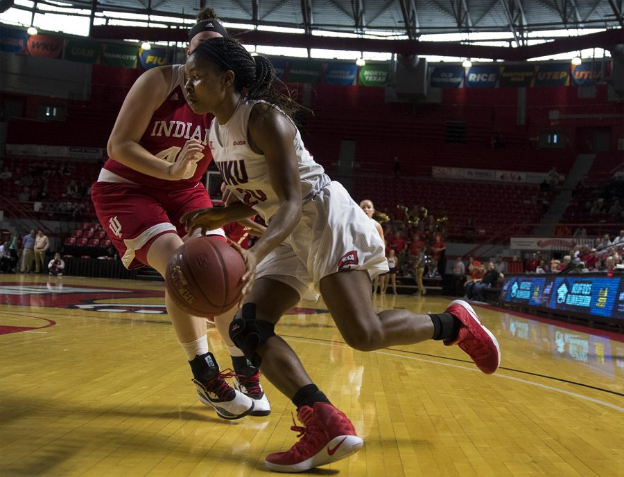 Senior+guard+Ima+Akpan+%2820%29+drives+to+the+basket+while+Indiana+Hoosiers+Senior+center+Jenn+Anderson+%2843%29+defends+during+the+Lady+Toppers%27+85-74+win+against+Indiana+University+Saturday+Nov.+19%2C+2016+at+E.A.+Diddle+Arena.