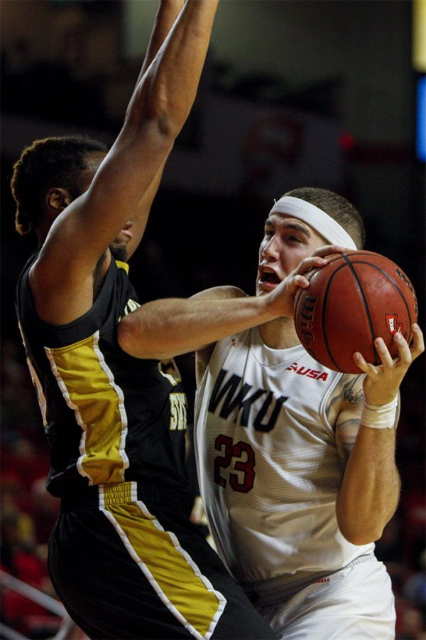 Junior+forward+Justin+Johnson+%2823%29+drives+to+the+basket+during+the+Hilltoppers+79-66+win+over+Alabama+State+on+Nov.+12%2C+2016+at+Diddle+Arena.