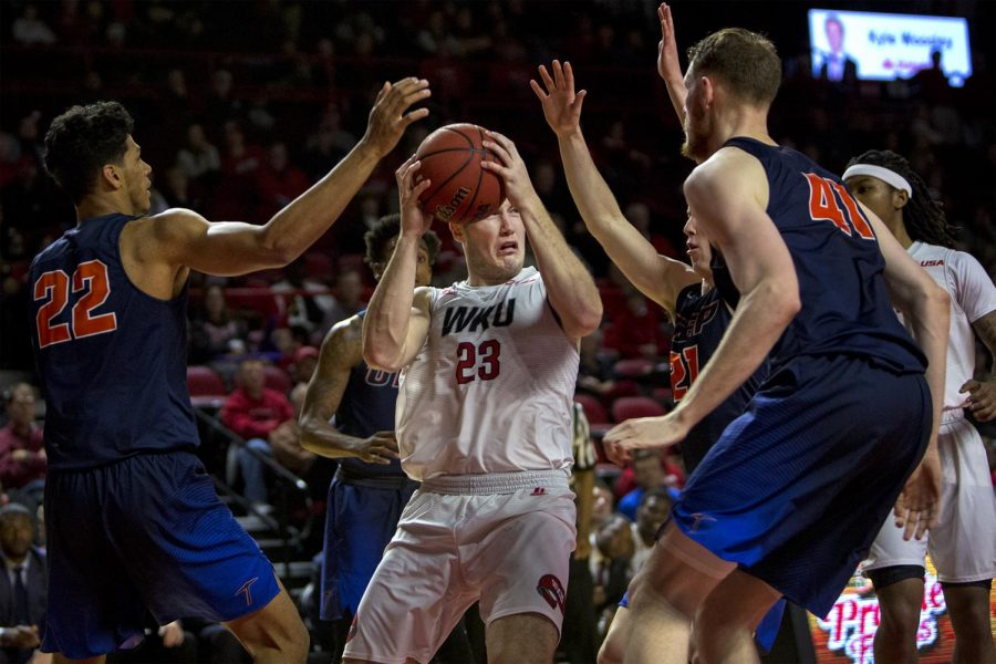 WKU forward Justin Johnson (23) looks to pass as he surrounded by University of Texas at El Passo during Hilltoppers 65-62 victory on Thursday, Jan. 26, 2017 at Diddle Arena.