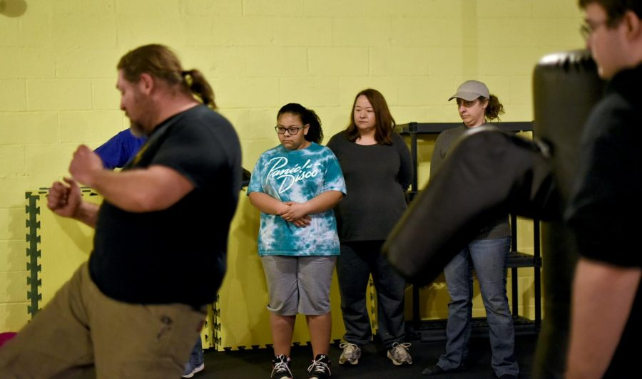 Selena Travis, 12, and her mother Vella Mae Travis, 43, focus on their instructor, Kevin Taylor, at the Womens Self Defense Workshop at Kentucky Grapplers on February 18th, 2017. I think its important for every woman to know how to protect themselves, said Vella Mae Travis.