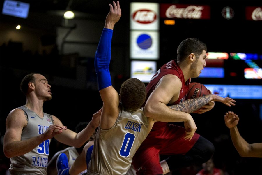 WKU forward Justin Johnson (23) and Middle Tennessee guard Tyrik Dickson (0) jump for a rebound during the Toppers 78-52 loss to Middle Tennessee State University on Thursday Feb. 16, 2017 in Diddle Arena.