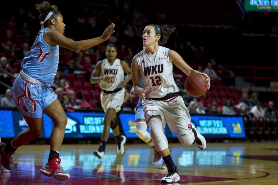 Redshirt senior guard Kendall Noble (12) drives to the basket as LA Tech's guard Kierra Lang (3) defends during the Lady Toppers' 67-58 win over LA Tech on Thursday Feb. 2, 2017 in Diddle Arena. (Ebony Cox/HERALD)