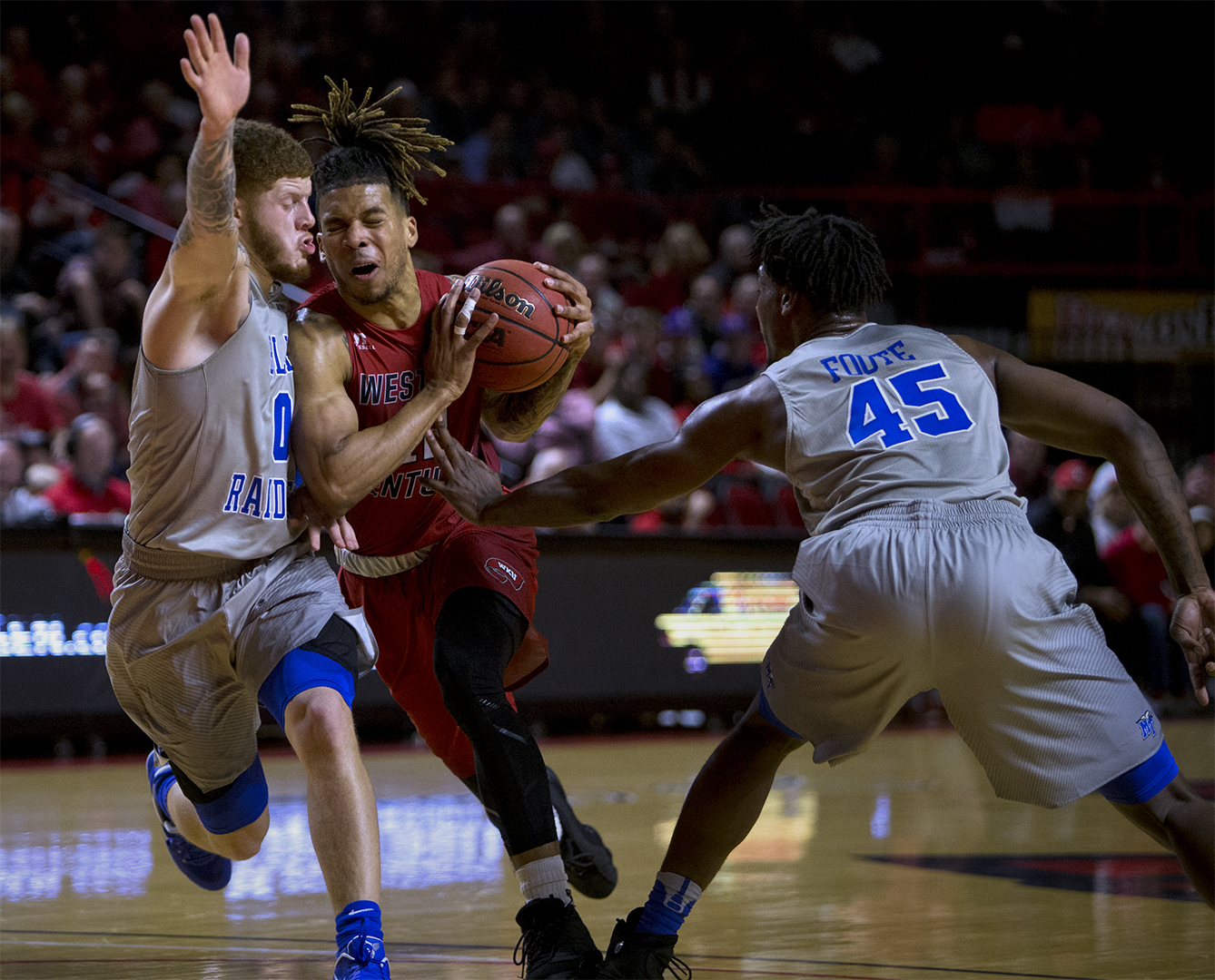 Redshirt Senior guard Pancake Thomas (12) drives to the hoop as he is defended by Middle Tennessee guard Tyrik Dickson (0) and guard Adonis Foote (45) during WKUs 78-52 loss to MTSU on Thursday Feb. 16, 2017 in Diddle Arena.