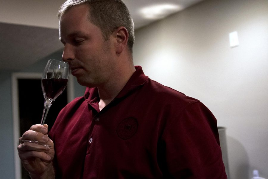 Drew+Rogers%2C+tests+the+maturity+of+a+wine+in+his+home+in+Smiths+Grove%2C+Ky.+where+he+and+his+wife%2C+Jessica%2C+are+fermenting+wines+for+their+business+Bluegrass+Vineyard.+%22I+lived+in+France+for+a+semester+in+high+school+and+got+an+appreciation+for+it%2C%E2%80%9D+Drew+said.