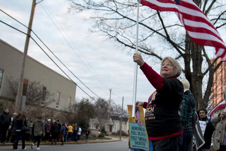 Claudia Hanes, a 66-year-old retired Bowling Green teacher, waves her
