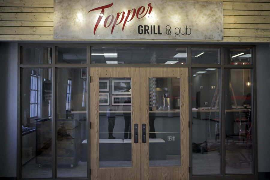 Topper+Grille+and+Pub+is+the+latest+addition+to+Western+Kentucky+Universities+Dining+options+on+campus.+Topper+Grille+and+Pub+is+located+on+the+first+floor+of+The+Garret+Conference+Center%2C+caddy+corner+to+Panda+Express.+It+will+serve+pub+style+food+such+as+burgers+and+pizza%2C+along+with+a+drink+menu+including+beer+and+wine.+The+bar+in+The+Topper+Grille+and+Pub+is+made+out+of+the+recycled+floor+from+the+bowling+alley+that+was+formerly+located+on+the+third+floor+in+The+Downing+Student+Union.