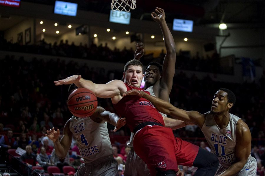 WKU junior forward Justin Johnson (23) struggles for the ball under the basket against MTSU junior guard Edward Simpson and other MTSU players during their game on Thursday, February 16. MTSU won the game with a score of 78-52.