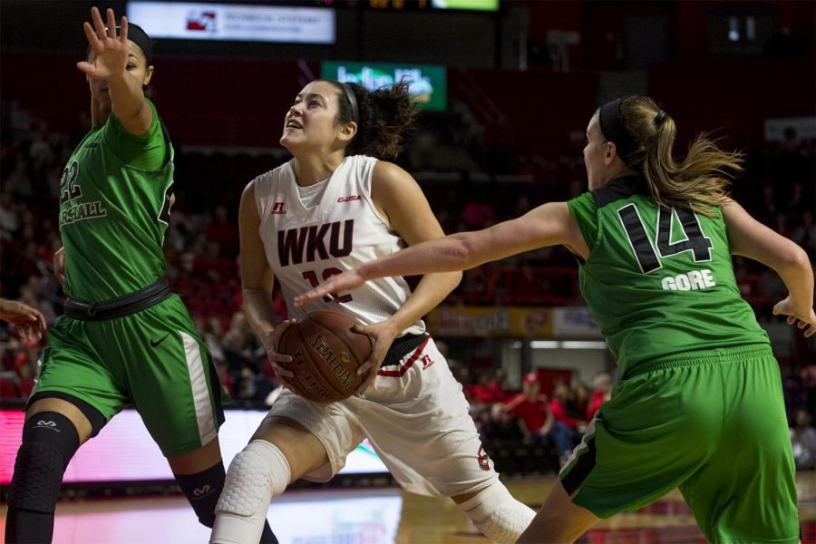 Senior Guard Kendall Noble (12) drives for a shot as she is defended by Marshall University guard Kiana Evans (22) and guard Shayna Gore (14) during the first half of the Lady Toppers 73-57 win over Marshall on Saturday Jan. 21, 2017 at Diddle Arena.