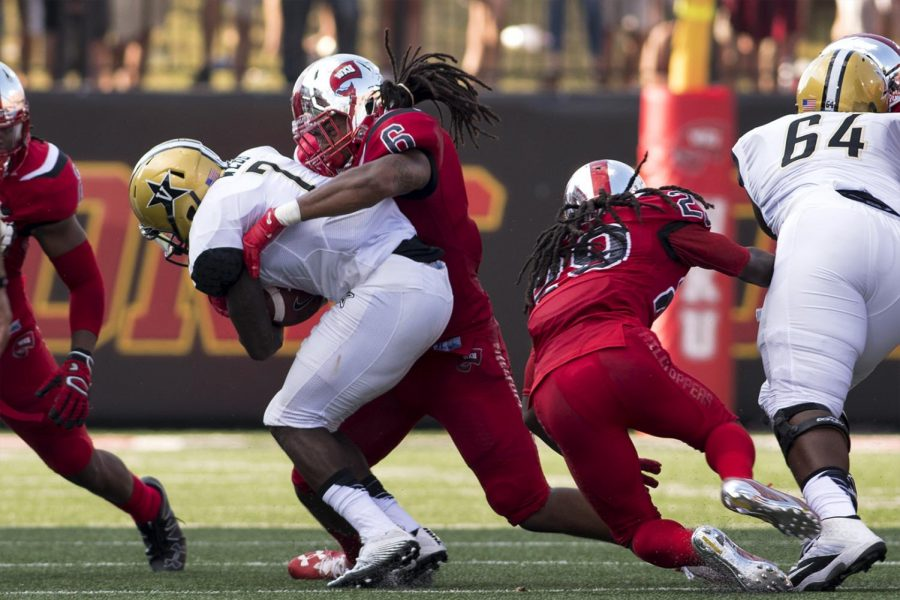 Vanderbilt+University+running+back+Ralph+Webb+%287%29+is+tackled+by+WKU+junior+linebacker+T.J.+McCollum+%286%29+during+the+Hilltoppers+game+against+Vanderbilt+on+Saturday+Sept.+24%2C+2016+at+L.T.+Smith+Stadium.+McCollum+transferred+to+Pordue+where+former+Hilltopper+Head+Coach+Jeff+Brohm+recently+took+the+head+coaching+position.