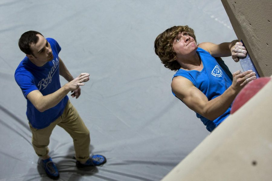 Noah+Brandt%2C+15%2C+Bowling+Green%2C+works+his+way+through+one+of+the+bouldering+courses+at+Vertical+Excape.+%E2%80%9CIt%E2%80%99s+good+exercise+and+a+good+challenge%2C+It%E2%80%99s+fun+on+working+on+something+and+getting+better+at+it%2C%E2%80%9D+Brandt+said.+Nate+Morris%2C+22%2C+of+Kansas+City%2C+Missouri%2C+guides+him+through+to+reach+the+top+of+the+course.