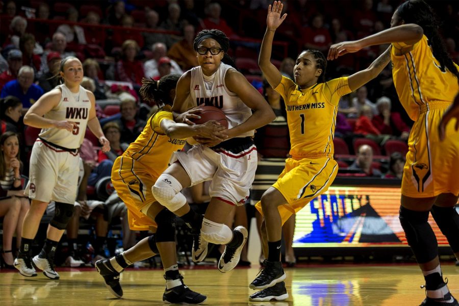 Junior+forward+Tashia+Brown+%2810%29+fights+for+ball+control+during+the+Lady+Toppers%27+79-53+win+over+Southern+Mississippi+on+Saturday+Feb.+4%2C+2016+in+Diddle+Arena.