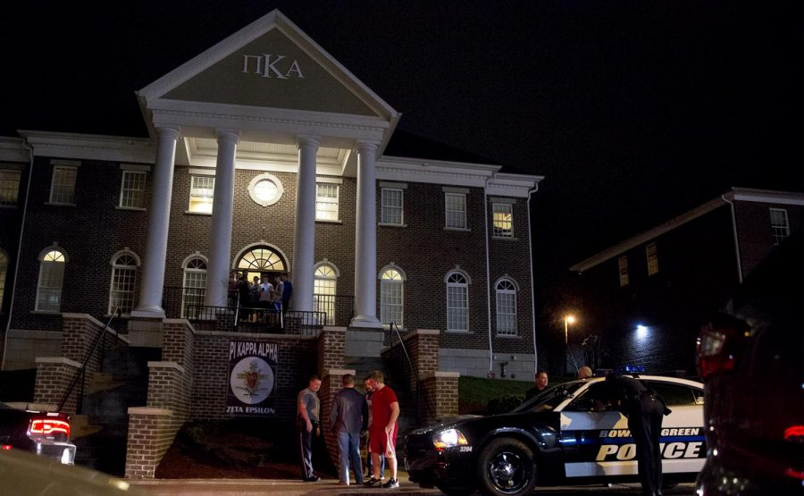 Members of Pi Kappa Alpha (Pike) stand outside their fraternity house late Sunday night. Bowling Green police respond to the scene where an alleged fight and a break-in involving WKU football players.