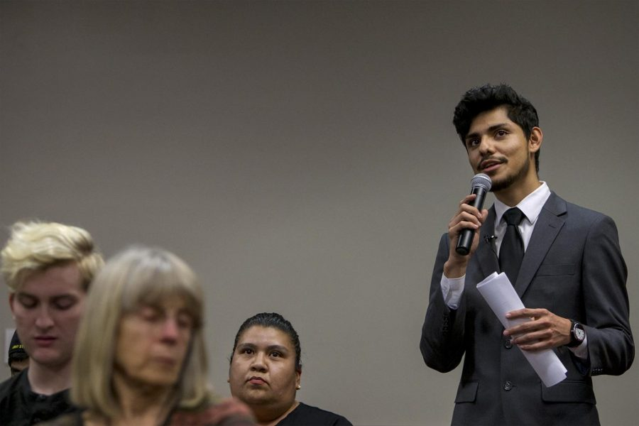 Francisco Serrano translates Laura Torras question from Spanish to English for the panel of lawyers on Feb. 28, 2017 in DSU. Torras questions was about how she should act if immigration officers come to her house.