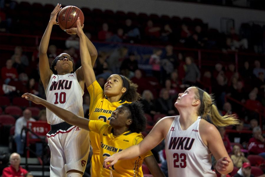 WKU+forward+Tasha+Brown+%2810%29+makes+a+jumps+shot+over+Southern+Miss+players+during+the+Lady+Toppers%27+79-53+win+over+Southern+Miss+on+Saturday+Feb.+4%2C+2017+in+Diddle+Arena.