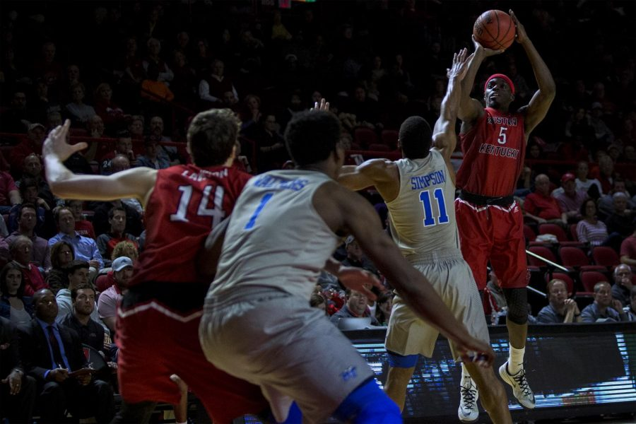 WKU redshirt senior guard Junior Lomomba (5) jumps up for a shot against MTSU junior guard Edward Simpson (11) during their game on Thursday, February 16. MTSU won the game with a score of 78-52.