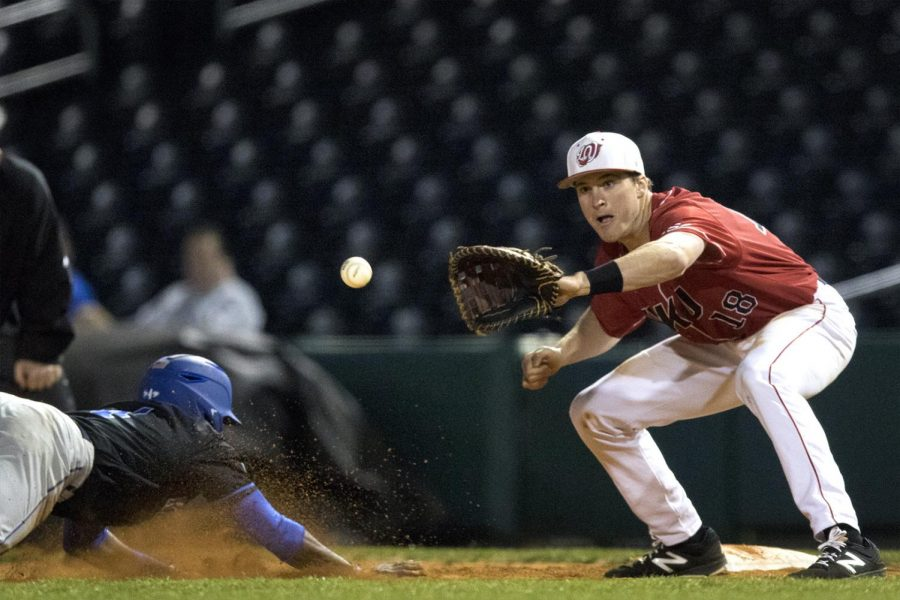 Junior+first+baseman+Nathan+Methuen+%2818%29+catches+the+ball+as+UKs+infielder+Zeke+Lewis+%284%29+slides+into+base+during+the+Hilltoppers+4-3+loss+against+UK+on+Tuesday+Mar.+21%2C+2017+at+the+Bowling+Green+Hot+Rods+stadium.