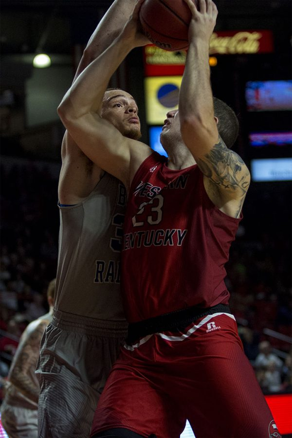 WKU+junior+forward+Justin+Johnson+%2823%29+takes+the+ball+up+for+a+shot+against+Middle+Tennessee+State+University+sophomore+forward+Reggie+Upshaw+%2830%29+during+their+game+on+Thursday%2C+February+16.+MTSU+won+with+a+score+78-52.