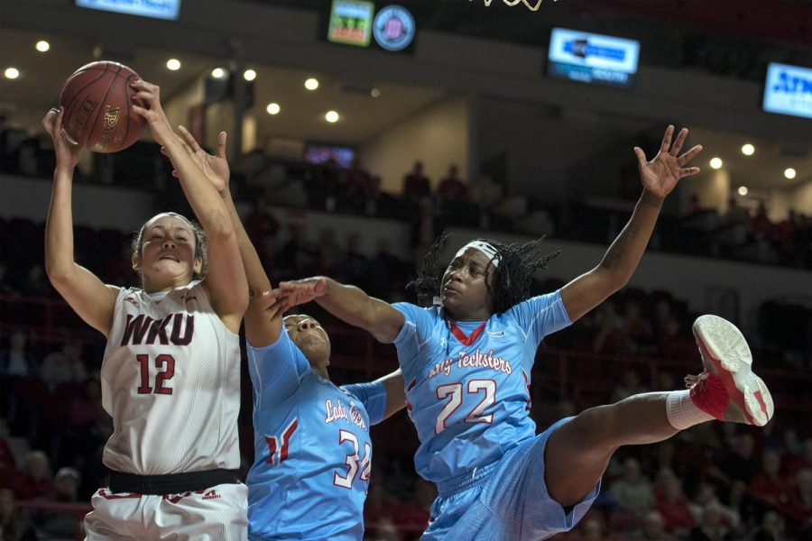 Senior guard Kendall Noble (12) snags a rebound over Louisiana Tech guard Jasmine LeBlanc (22) and junior forward Alexus Malone (34) during the Lady Toppers 67-58 win against Louisiana Tech on Thursday, Feb. 2, 2017 at Diddle Arena. Jack Atkerson/ Herald