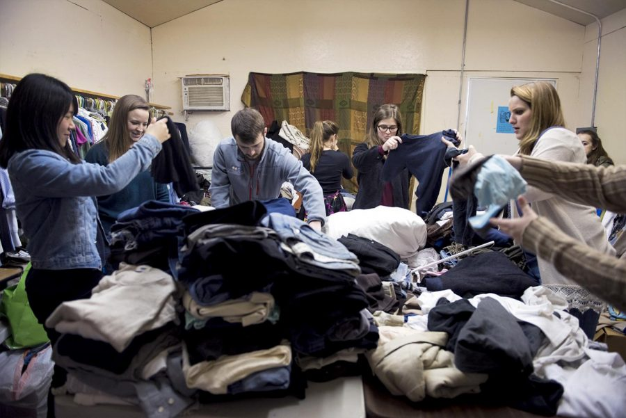 WKU+Students+volunteer+at+the+International+Center+of+Kentucky+on+March+3+by+sorting+and+folding+clothing+donations+for+refugees.+The+resettlement+agency+helps+immigrants+%22fully+integrate+and+thrive+in+the+United+States%22+according+the+the+organization%27s+website.+WKU+graduate+Kaycee+Gibson+%28far+right%29%2C+22%2C+of+Horse+Cave%2C+Ky.+who+is+the+volunteer+coordinator%2C+says+it+receives+%22tons+of+clothing+donations+almost+every+day...we+just+don%27t+have+the+hands+to+do+it.%22