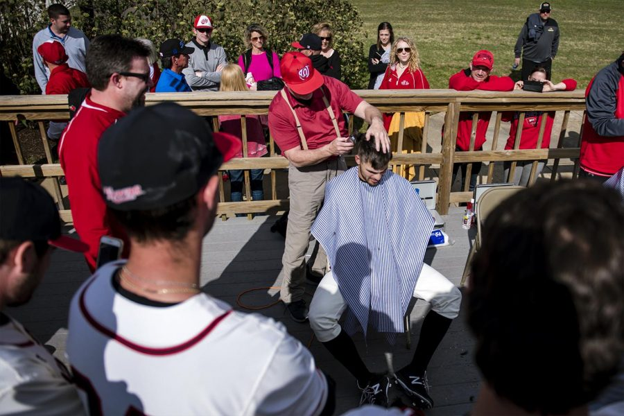 Jeff+Jones+shaves+WKU+junior+Devon+Loomis+head+after+WKUs+loss+Southern+Miss+on+Saturday+at+Nick+Denis+Field.+Jones+along+with+his+teammates+shaved+their+heads+in+support+of+those+battling+cancer.