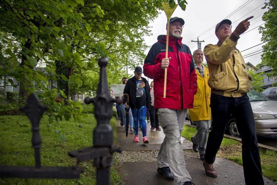 Rick Olson (left) walks with Professor Keith Philips (right) during the March for Science on Saturday, March 22, 2017 in Bowling Green. Olson, who is an ecologist at the Mammoth Cave National Park, says