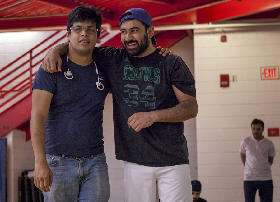 Jahanzaib Khan (left) and Shahraze Hamood (right) came out to the International Olympics at WKU's Preston Center to support the teams.